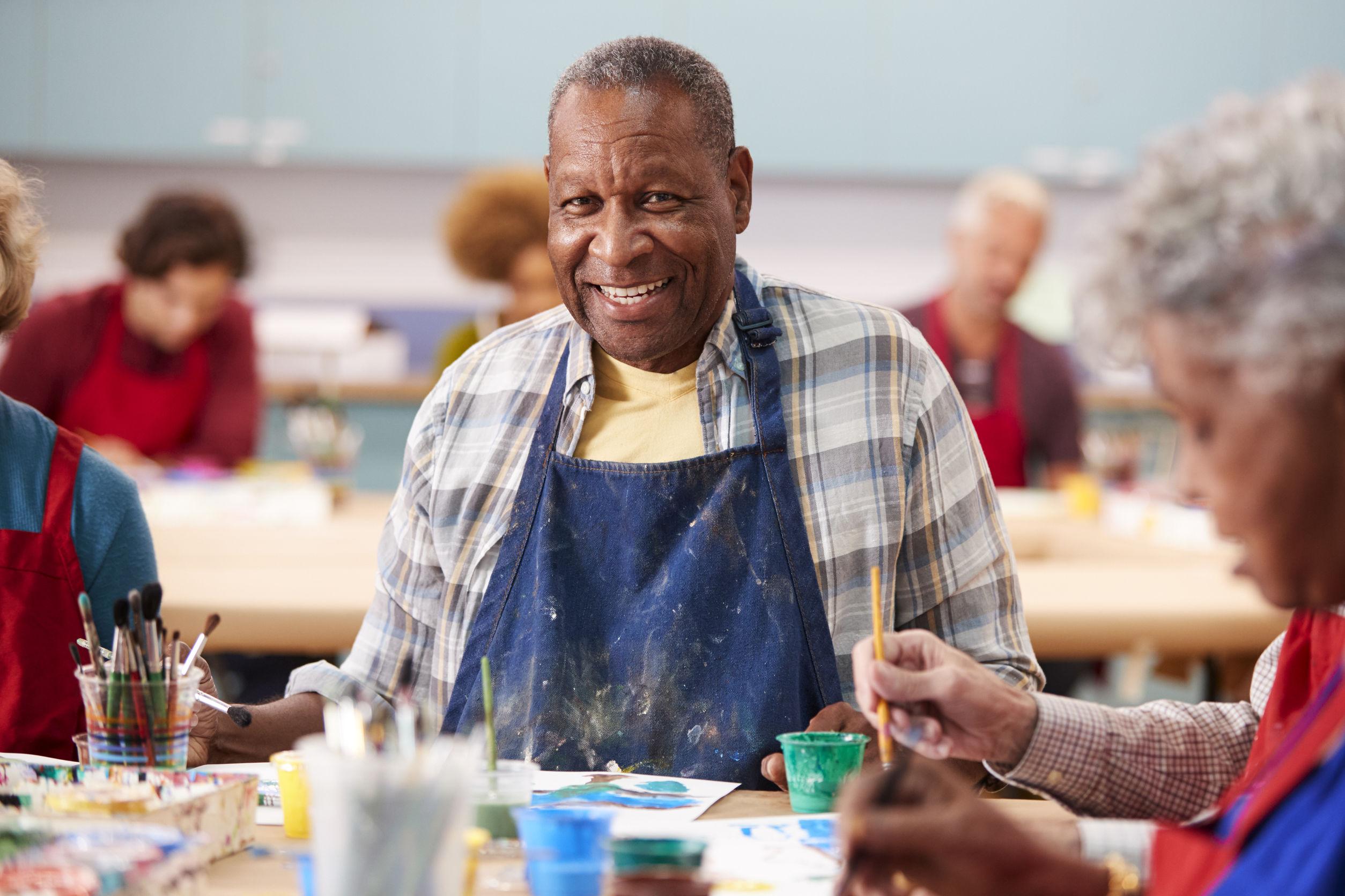 Portrait Of Retired Senior Man Attending Art Class